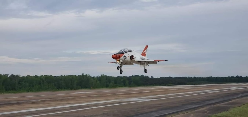 """Italian navy Ensign Erika Raballo, a student naval aviator assigned to the """"Tigers"""" of Training Squadron (VT) 9, completes her first solo flight in a T-45C Goshawk jet trainer aircraft at Naval Air Station Meridian, April 10, 2020."""