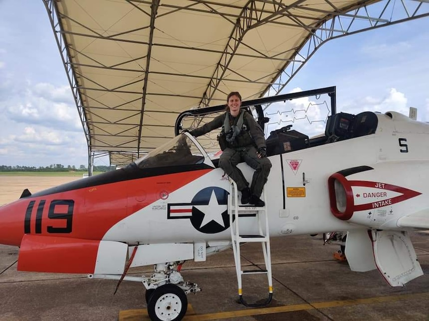 """MERIDIAN, Miss. (June 2, 2020) Italian navy Ensign Erika Raballo, a student naval aviator, sits on a T-45C Goshawk jet trainer aircraft after completing her a training flight with the """"Tigers"""" of Training Squadron (VT) 9 at Naval Air Station Meridian, June 2, 2020."""