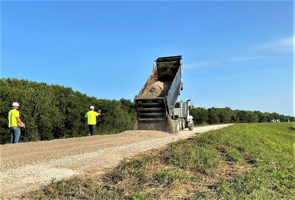 IN THE PHOTO, A Rock Construction works to resurface the levee crown near Phillips County, Arkansas. 2019 flood damage supplemental funds funded the project.