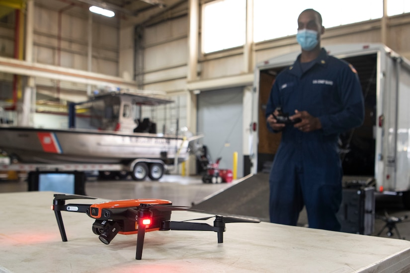 Photo of a U.S. Coast Guard Atlantic Strike Team member using a drone.