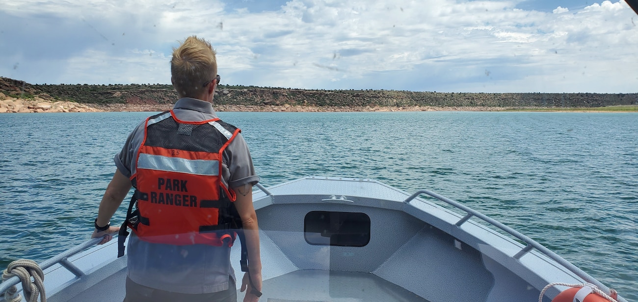 Cochiti Park Ranger Karyn Matthews on boat patrol at Conchas Lake, Aug. 15, 2020. Because Cochiti Lake was closed during the summer of 2020, some of the park rangers assigned there assisted at other district lakes. Photo by Jonathan Hicks.