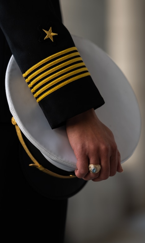 A sailor shows her class ring.