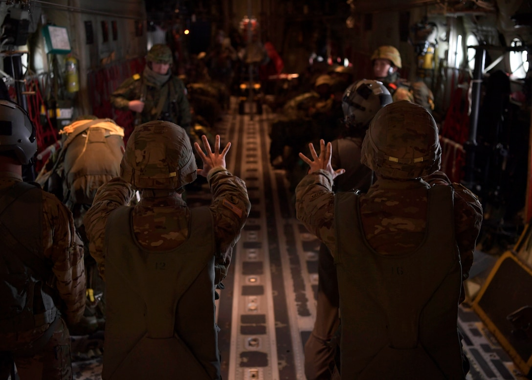 U.S. and Japanese soldiers get the word that their jump from a C-130 is in 10 minutes.