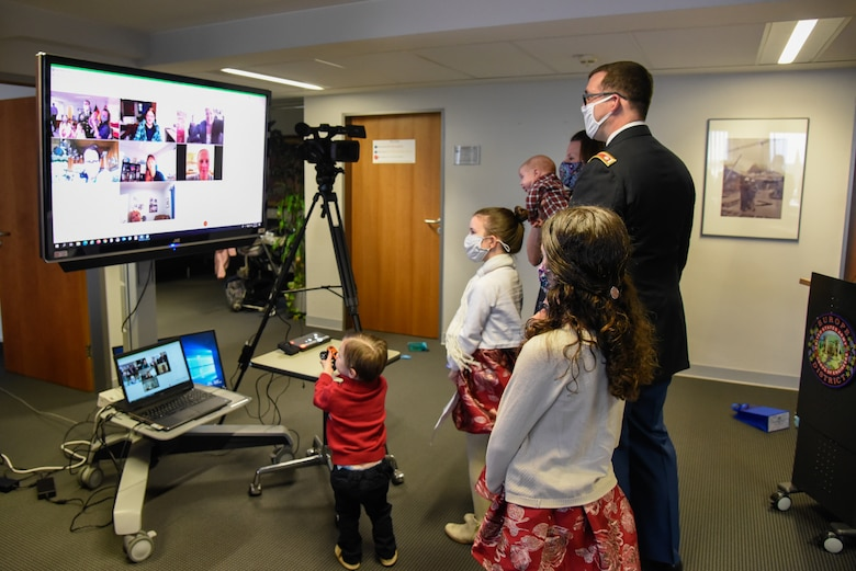 U.S. Army Corps of Engineers, Europe District Deputy Commander Lt. Col. Daniel J. Fox and his family chat with friends and family that joined them virtually for his promotion ceremony in Wiesbaden, Germany Feb. 26, 2021. (U.S. Army photo by Alfredo Barraza)