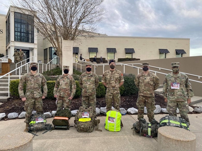 U.S. Army Engineer Research and Development Center Soldiers Capt. Jeremiah Paterson, ERDC Commander Col. Teresa Schlosser, Maj. Earl Dean, British Liaison Maj. Peter Mackintosh, Capt. Patrick Border and Lt. Col. Christian Patterson rally with 25-pound ruck sacks in advance of the 18.6-mile Norwegian Foot March at Camp Shelby Joint Forces Training Center, near Hattiesburg, Miss., March 6, 2021. (U.S. Army Corps of Engineers photo)