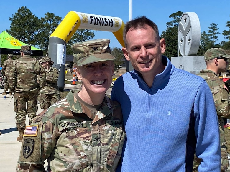 U.S. Army Engineer Research and Development Center Commander Col. Teresa Schlosser and spouse, Tim Cutler, pose for a picture after completing the 18.6-mile Norwegian Foot March/Run at Camp Shelby Joint Forces Training Center, near Hattiesburg, Miss., March 6, 2021. Schlosser was recognized for an exceptional completion time for the march, and Cutler earned first place in the 18.6-mile trail run. (U.S. Army Corps of Engineers photo)