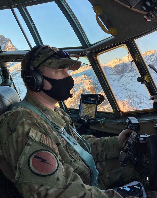 U.S. Air Force Lt. Col. Josh Panis, 118th Airlift Squadron assistant director of operations and mission aircraft commander, flies a C-130H Hercules over Greenland Feb. 10, 2021. The 103rd Airlift Wing transported 12 National Science Foundation personnel and their equipment from Stratton Air National Guard Base in Scotia, New York, to Kangerlussuaq, Greenland, for the beginning of their annual climate research mission at Greenland's ice cap.