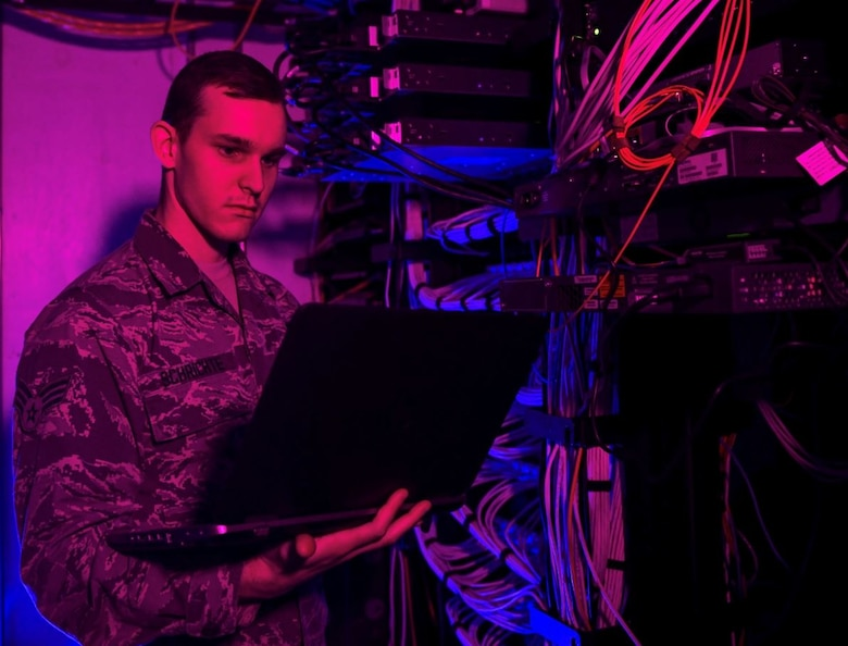 Senior Airman Alexander Schrichte, 460th Space Communications Squadron client systems technician, performs routine technical checks on network servers in November 2018 at Buckley Air Force Base, Colorado. Buckley is one of eight Air and Space Force locations currently receiving EITaaS end user service upgrades that provide Airmen and Guardians a consolidated service desk and catalog, faster login times, and higher functioning devices (U.S. Air Force photo by Airman 1st Class Michael D. Mathews)