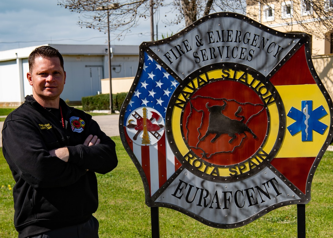 Assistant Chief of Training Thomas Wiley poses for a photo at the Naval Station Rota Fire and Emergency Services building on Naval Station Rota, Spain.