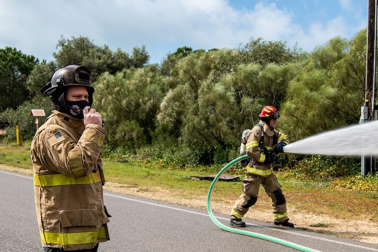 Assistant Fire Chief Thomas Wiley calls in on the radio to signal the end of the National Fire Protection Association 1410 drill being conducted by Naval Station (NAVSTA) Rota's Fire and Emergency Services Department at NAVSTA Rota, Spain Mar. 03, 2021