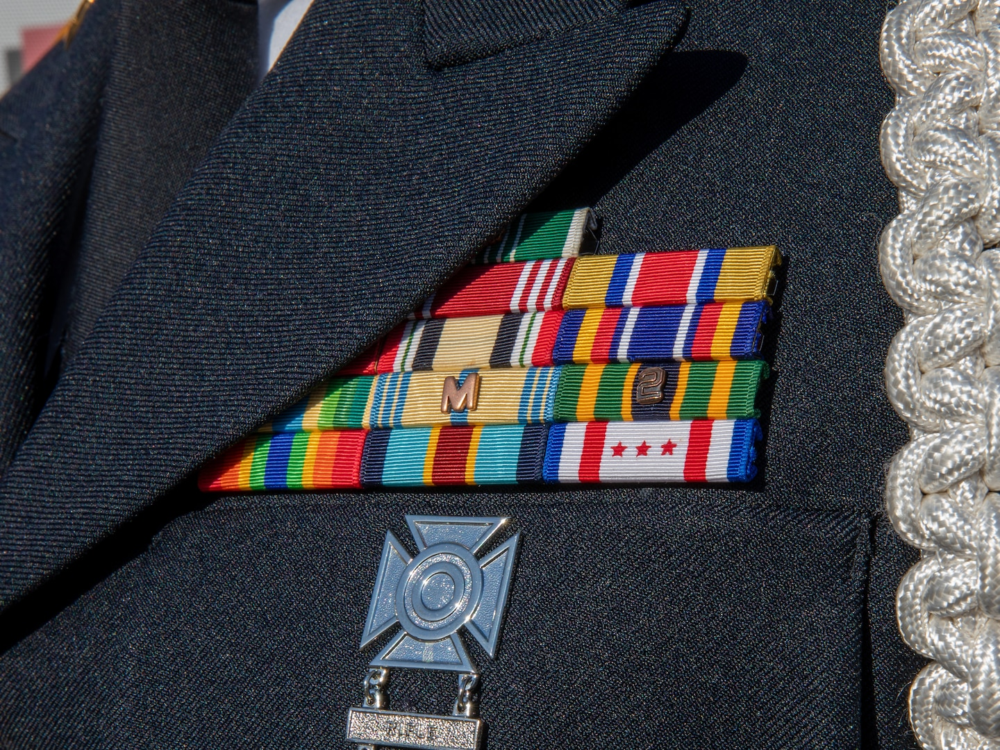 Military awards worn by a District of Columbia Army National Guard Soldier in Washington, D.C., March 10, 2021, include the D.C. National Guard Presidential Inauguration Support Ribbon on the bottom right. The ribbon is authorized for award to National Guard members from any state, territory or the District of Columbia who supported the 59th presidential inauguration on Title 32 orders.