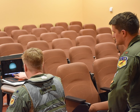 Lt. Col. John Tice, 442d Fighter Wing, shows children how night vision goggles work via video conference with Children's Mercy Hospital at Whiteman AFB, Missouri, Mar. 11. 2021.