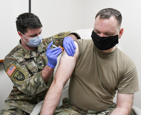 Sgt. Dillon Henderson with the Tennessee Army National Guard administers a COVID-19 vaccine to Master Sgt. Frank Mancino, an Arnold Engineering Development Complex team member, at Arnold Air Force Base, Tenn., Feb. 23, 2021, at the Medical Aid Station on base. (U.S. Air Force photo by Jill Pickett)