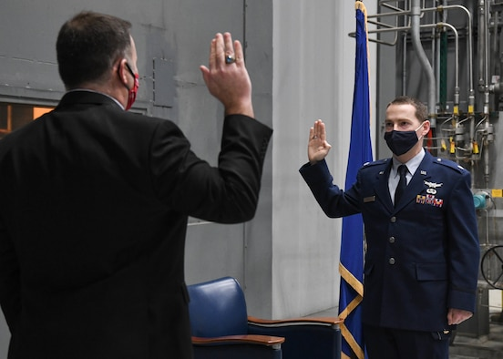 Brian Knauf, retired Air Force lieutenant colonel, left, administers the oath of office to his brother, newly-promoted Lt. Col. Michael Knauf during a promotion ceremony, March 1, 2021, at Arnold Air Force Base, Tenn. (U.S. Air Force photo by Jill Pickett)