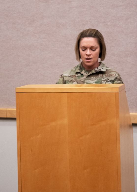 Tech. Sgt. Briana Lutes, event coordinator for the Senior Non-commissioned Officer Induction Ceremony, opens the event with a speech on Whiteman Air Force Base, Missouri, March 6, 2021. The ceremony recognizes Airmen who have recently been promoted into the first tier of the SNCO ranks. (U.S. Air National Guard photo by Airman 1st Class Whitney Erhart)