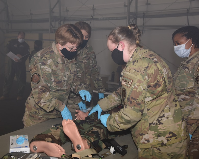 Lt. Gen. Dorothy Hogg, U.S. Air Force and Space Force surgeon general, looks over the augmented mannequin used in the Tactical Combat Casualty Care All Combatants course Mar. 12, 2021, provided by Columbus Air Force Base, Miss. With readiness being the number one priority of Hogg and a priority across the DoD, Columbus AFB 14th Medical Group is making sure the Airmen are getting the proper tactical medical training. (Air Force photo by Elizabeth Owens)