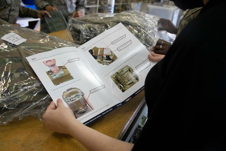 a pamphlet is held by a person.