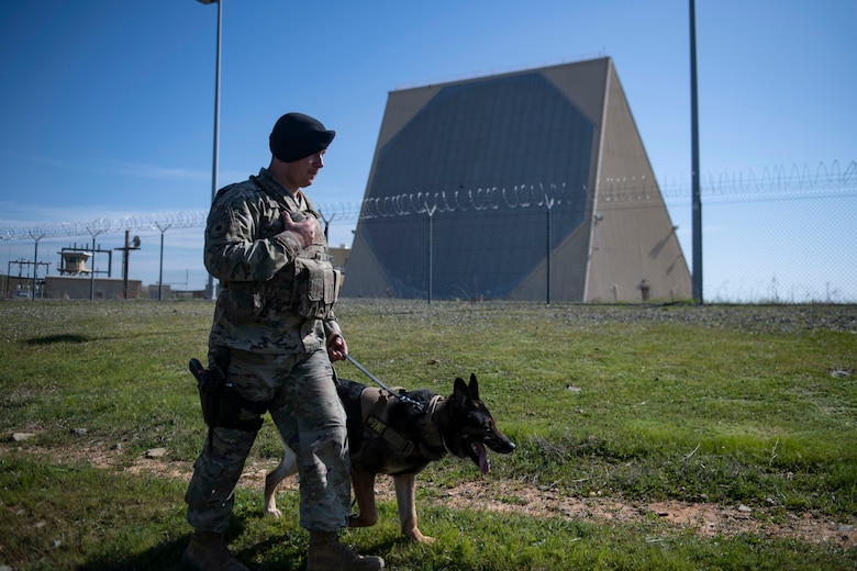 Staff Sgt. Jason Herrier, 9th Security Forces Squadron (SFS) military working dog (MWD) handler and Bady 2, 9th SFS MWD patrol around the 7th Space Warning Squadron on Beale Air Force Base.