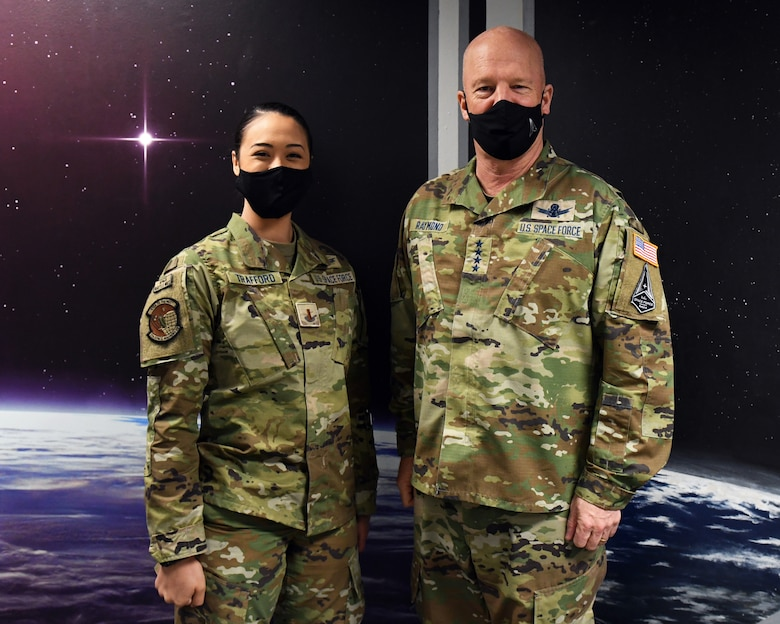 """U.S. Space Force Gen. John W. """"Jay"""" Raymond, Chief of Space Operations, right, and U.S. Space Force 2nd Lt. Miriam Trafford, 7th Space Warning Squadron crew commander, left, pose for a photo March 11, 2021, at Beale Air Force Base, California. (U.S. Air Force photo by Airman 1st Class Luis A. Ruiz-Vazquez)"""