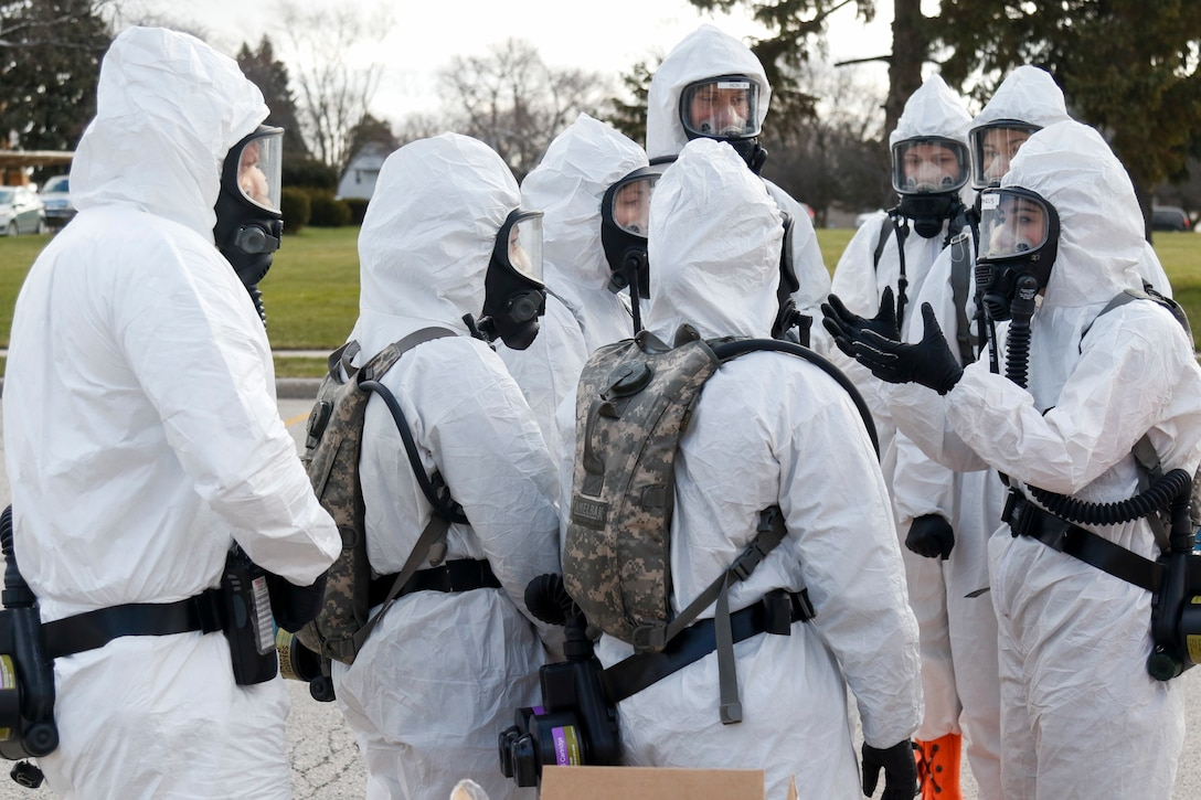 A Wisconsin National Guard specimen collection team sent to a senior living facility in Sheboygan prepares to test staff and residents for COVID-19 as part of the Guard's year-long support of the state pandemic response.