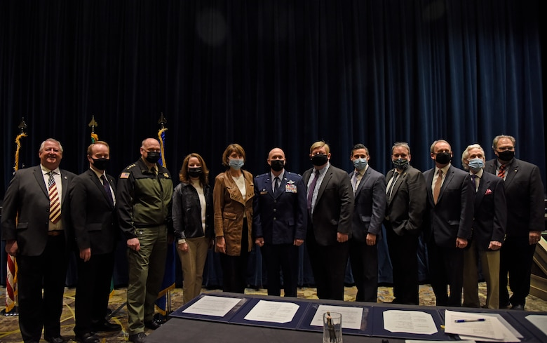 Representatives from Fairchild Air Force Base, the Spokane County Sheriff's Office, and the Spokane County Board of Commissioners pose for a group photo on March 15, 2021, in Airway Heights, Washington. An event was held to sign a one-of-a-kind Intergovernmental Support Agreement (IGSA) for the Spokane Regional Indoor Small Arms Range Partnership. (U.S. Air Force photo by Staff Sgt. Jesenia Landaverde)