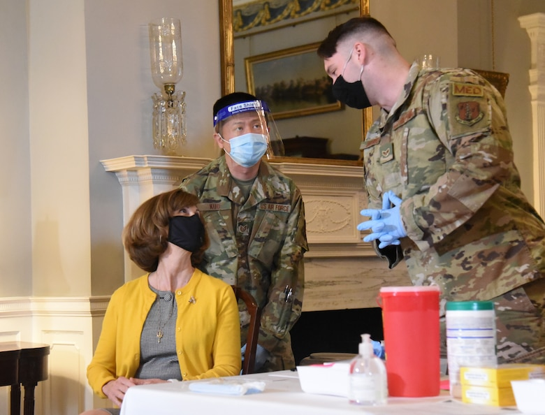 Virginia National Guard personnel administer the COVID-19 vaccine to Virginia Gov. Ralph Northam and Virginia First Lady Pamela Northam March 15, 2021, at the Executive Mansion in Richmond, Virginia.