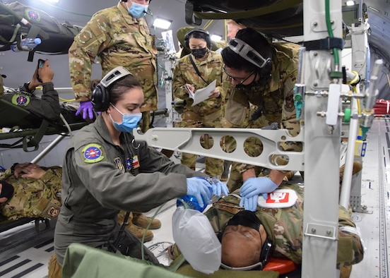 433rd Aeromedical Evacuation Squadron personnel respond to a simulated patient emergency during a KC-46A Pegasus local flight from Joint Base San Antonio-Lackland, Texas, March 10, 2021. The Airmen were conducting initial qualification training on the new aircraft. (U.S. Air Force photo by Tech. Sgt. Iram Carmona)