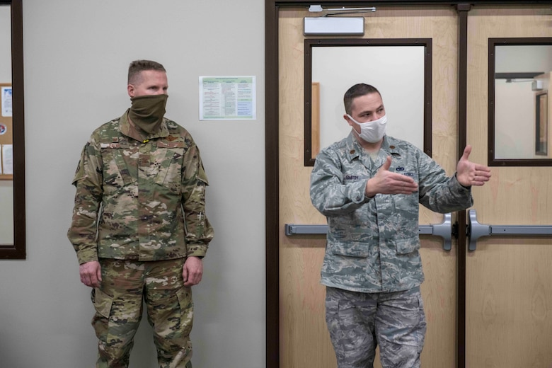 Maj. Kregg Smith (right), operations officer in the 419th Logistics Readiness Squadron, describes how the newly created deployment readiness cell will streamline pre-deployment and post-deployment processes for Airmen Mar. 6, 2021, at Hill Air Force Base, Utah.