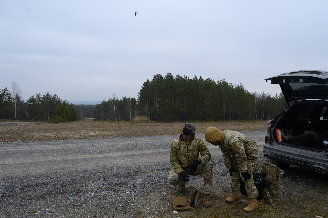 An Airman looks on at a drone.