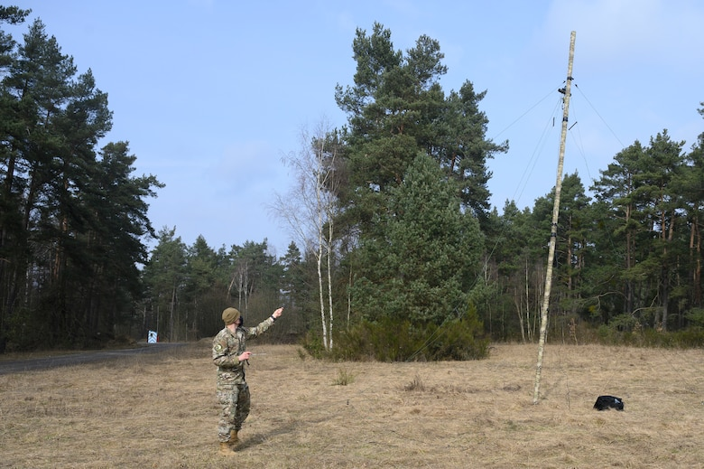 An Airman sets up a high frequency antenna.