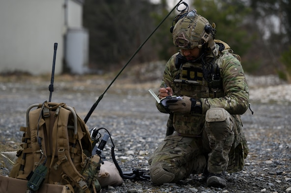 An Airman writes in his notebook.