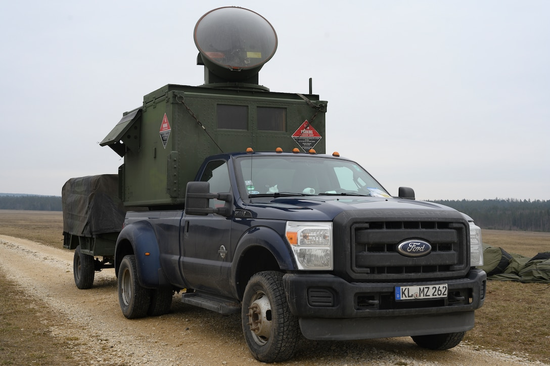 A surface-to-air-threat emitter sits on a government vehicle.