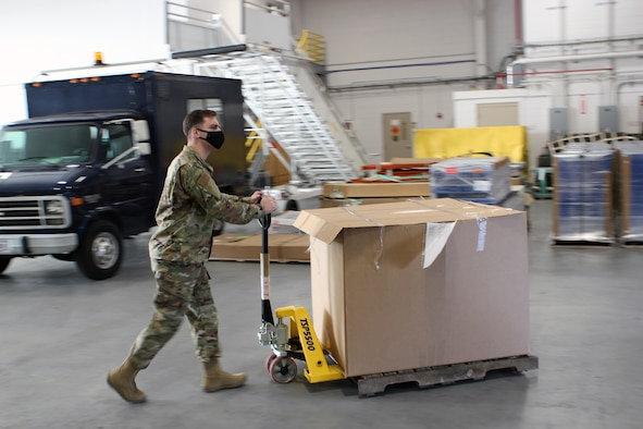 Senior Airman Jacob Milatz, a material management specialist with the 127th Logistics Readiness Squadron, moves a pallet of equipment in a warehouse at Selfridge Air National Guard Base, Mich., Jan. 9, 2020.  (U.S. Air National Guard photo by Master Sgt. Dan Heaton)