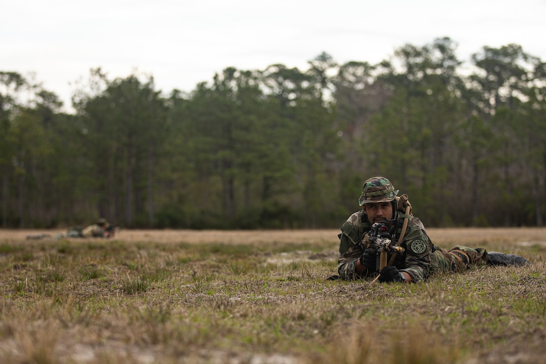 Dutch Marine Cpl. Axel Kuijer with 32nd Raiding Squadron provides security during Combat Tracking training on Camp Lejeune, N.C., March 13, 2021. Marines train to follow paths and signs left behind from persons of interest. Exercise Caribbean Urban Warrior is a bilateral training evolution designed to increase global interoperability between 2d Reconnaissance Battalion, 2d Marine Division and 32nd Raiding Squadron, Netherlands Marine Corps.(U.S. Marine Corps photo by Cpl. Armando Elizalde)
