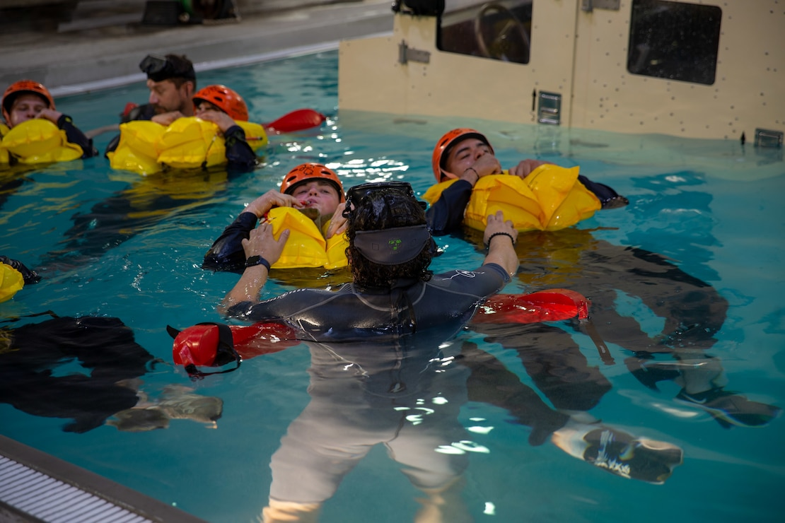 U.S. Marines with Alpha Company, 2d Assault Amphibian Battalion, 2d Marine Division, rehearse egress techniques from a sinking assault amphibious vehicle during an underwater egress training on Camp Lejeune, N.C., March 11, 2021. Underwater egress training is a life-saving course that provided service members with the skills and confidence to successfully and safely remove themselves from an assault amphibious vehicle, light armored vehicles and helicopters that may be submerged in water. (U.S. Marine Corps photo by Lance Cpl. Juan Magadan)