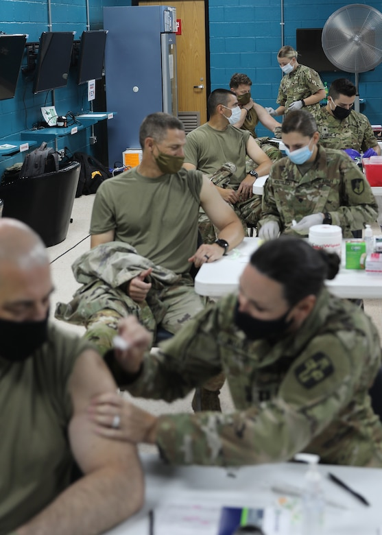 Soldiers received the Janssen COVID-19 vaccine at the March 13, 2021 rollout of Operation Med Spear at Camp Arifjan, Kuwait, from medical Soldiers deployed to the camp with the Army Reserve's 228th Combat Support Hospital. The Janssen vaccine was approved for use by the Food and Drug Administration Feb. 27, 2021 and is already in theater for wide distribution. (U.S. Army photo by Staff Sgt. Neil W. McCabe)