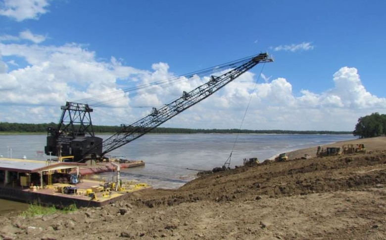 IN THE PHOTO, our current bank grading unit. The equipment used to 'grade' the river bank is a vintage 1949 barge mounted Bucyrus-Erie dragline with a 183 foot boom and a 15 cubic yard bucket. Additional earthmoving capacity is provided by a compliment of bulldozers. Channel Improvement Team members discussed the future replacement of this bank grading unit by the Seatrax unit pictured below.