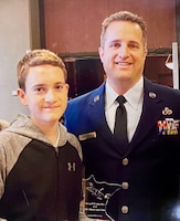 Joey Gigliotti poses for a photo with his father, Chief Master Sgt. Ryan Gigliotti. Joey Gigliotti is the third generation of his family to serve in the Air National Guard. (Courtesy Photo)