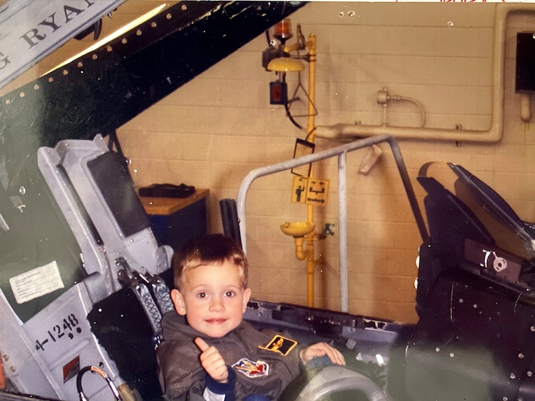 Joey Gigliotti poses for a photo in the cockpit of an F-16 Fighting Falcon during a Family Day event at the 148th Fighter Wing. Gigliotti is the third generation of his family to serve in the Air National Guard. (Courtesy Photo)