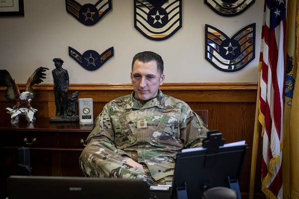 New Jersey state Command Chief Master Sgt. Michael Rakauckas prepares to talk with 108th Wing and 177th Fighter Wing Airmen during his first virtual all-call at Joint Base McGuire-Dix-Lakehurst, N.J., March 14, 2021.