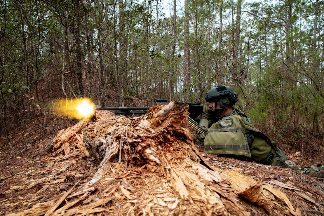 Netherlands Marine Corps Marine Class 1 Joey with 32nd Raiding Squadron fires an M240B machine gun during Exercise Caribbean Urban Warrior on Camp Lejeune, N.C., March 15, 2021. The exercise is a bilateral training evolution designed to increase global interoperability between 2d Reconnaissance Battalion, 2d Marine Division and 32nd Raiding Squadron, Netherlands Marine Corps. (U.S. Marine Corps photo by Lance Cpl. Jacqueline Parsons)