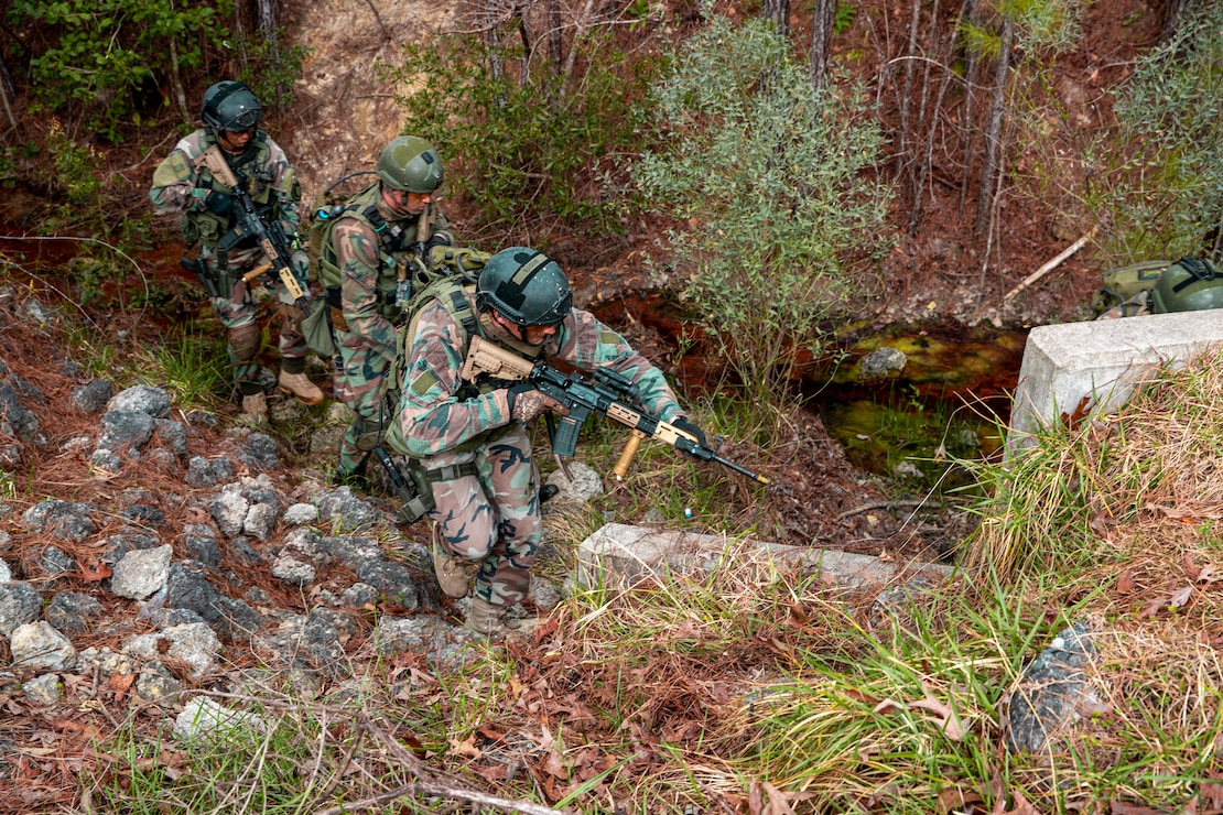 Dutch Marines with 32nd Raiding Squadron advance to the next objective during Exercise Caribbean Urban Warrior on Camp Lejeune, N.C., March 15, 2021. The exercise is a bilateral training evolution designed to increase global interoperability between 2d Reconnaissance Battalion, 2d Marine Division and 32nd Raiding Squadron, Netherlands Marine Corps. (U.S. Marine Corps photo by Lance Cpl. Jacqueline Parsons)