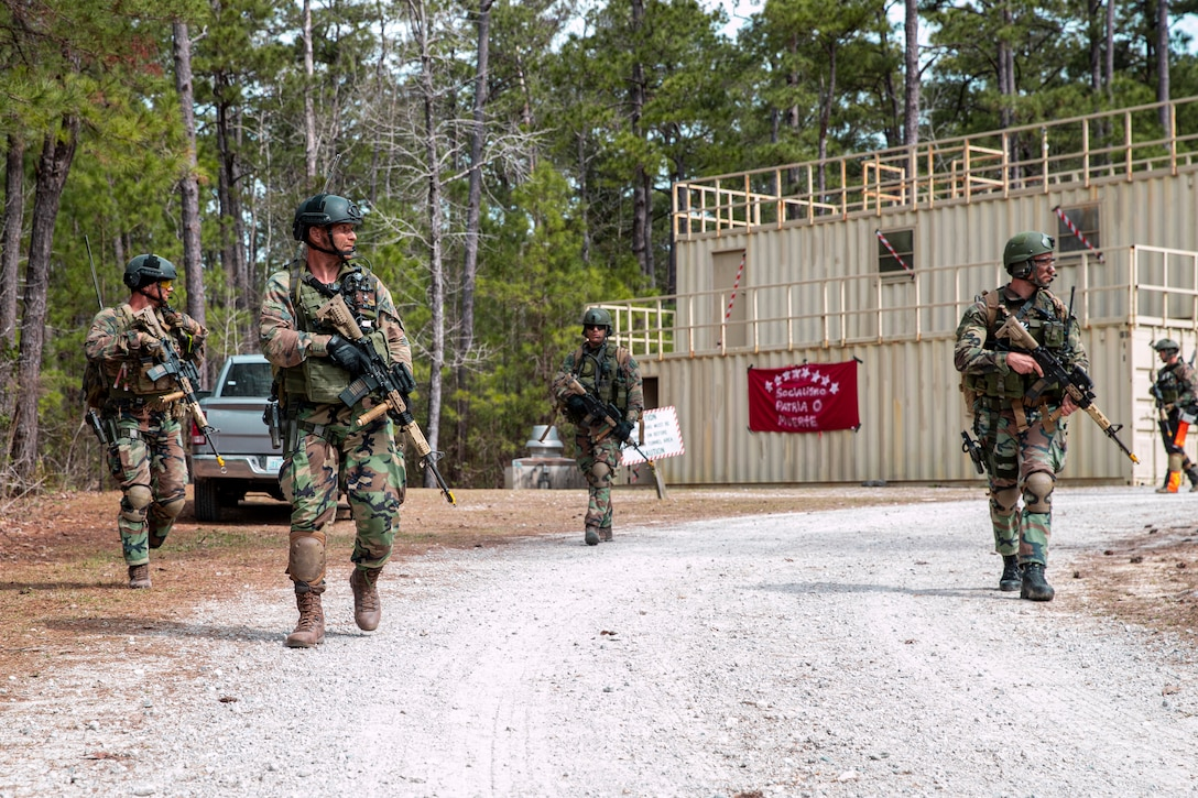 Dutch Marines with 32nd Raiding Squadron patrol during Exercise Caribbean Urban Warrior on Camp Lejeune, N.C., March 15, 2021. The exercise is a bilateral training evolution designed to increase global interoperability between 2d Reconnaissance Battalion, 2d Marine Division and 32nd Raiding Squadron, Netherlands Marine Corps. (U.S. Marine Corps photo by Lance Cpl. Jacqueline Parsons)