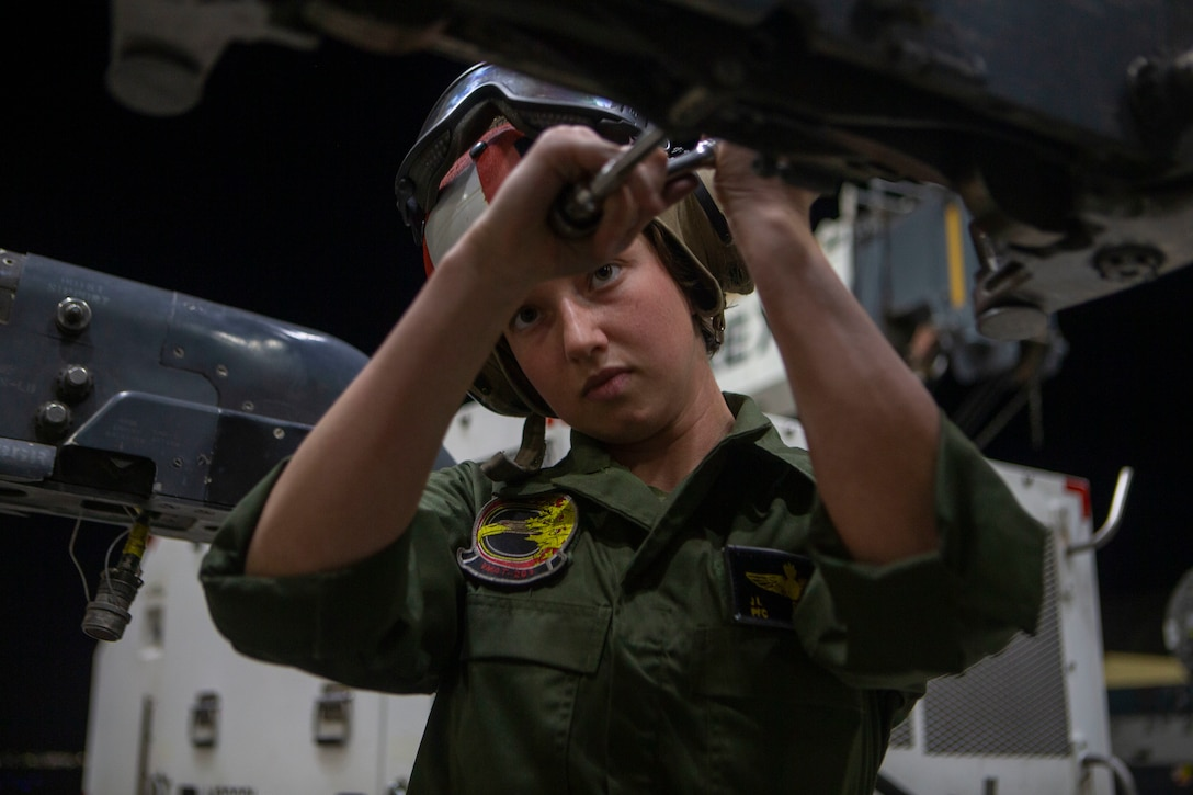 Private First Class JennaMarie Drinkwater, an aircraft ordnance technician,  disassembles the part of wing that hold the ordnance of the AV- 8B Harrier II at Marine Corps Air Station Yuma, Arizona, January 21, 2021. Marines with Marine Attack Training Squadron 203 (VMAT-203) trained with ordnance in an unfamiliar environment in order to increase proficiency in critical mission skills such as low altitude tactics, complex maneuvers, and close air support. VMAT-203 is a subordinate unit of 2nd Marine Aircraft Wing, which is the air combat element of II Marine Expeditionary Force. (U.S. Marine Corps Photo by Sgt. Servante R. Coba)