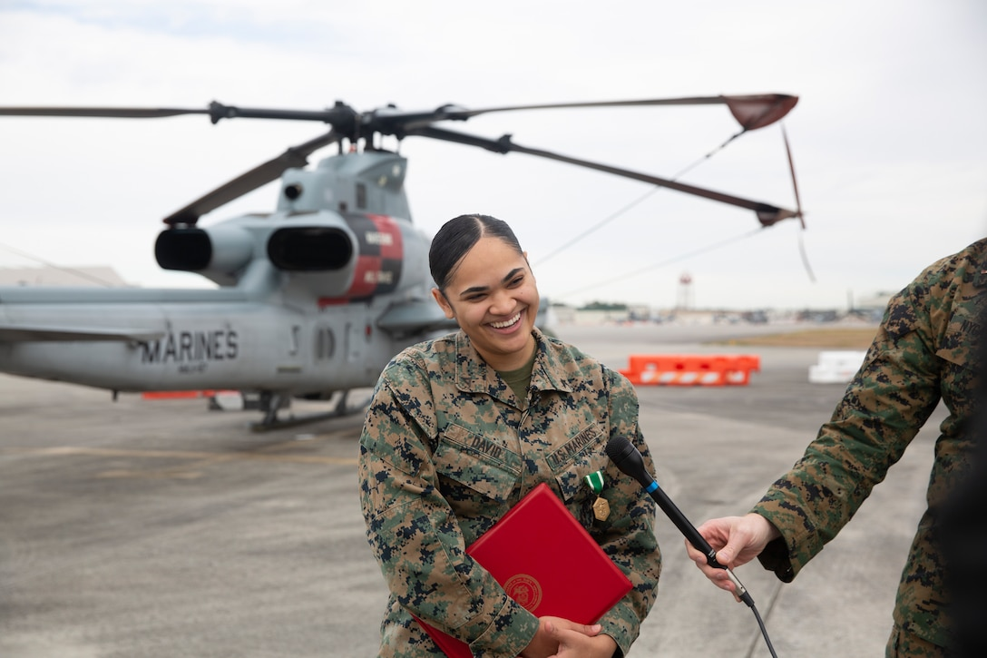 Lance Cpl. Alyssa David answer questions from local media at Marine Corps Air Station New River, North Carolina, January 22, 2021. Davis, a native of Bridgeport, Connecticut, serves as a maintenance administrative specialist at Marine Light Attack Helicopter Squadron 167. On the night of September 25, 2020, David came upon the scene of a vehicle collision where a tractor trailer struck a truck along Kinston Highway in Jacksonville, North Carolina. She immediately took charge of the scene, directed bystanders to call 911, and was able to triage and extract a toddler from the backseat of the vehicle. (U.S. Marine Corps photo by Lance Cpl. Yuritzy Gomez)