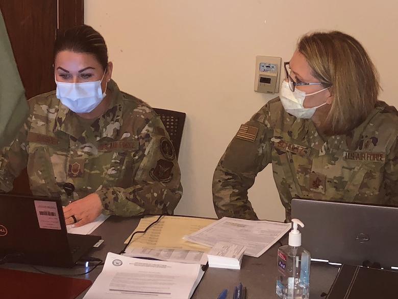 Master Sgt. Jenna Gasper, NCOIC of Immunizations and Major Dawn Schultz, AMDS/SGN nurse, record and monitor the lineup operations during process