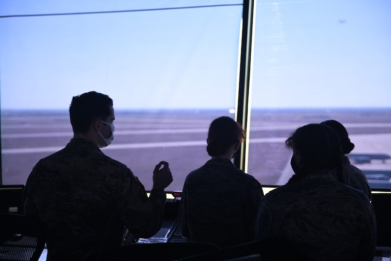 U.S. Air Force Staff Sgt. Jacob Graham, 97th Operations Support Squadron air traffic controller apprentice, answers questions from Air Force Junior Reserve Officers' Training Corps (AFJROTC) cadets in the control tower at Altus Air Force Base, Oklahoma, March 10, 2021. AFJROTC cadets toured the base to learn about how we train exceptional mobility Airmen and witness first-hand an active duty installation. (U.S. Air Force photo by Airman 1st Class Kayla Christenson)