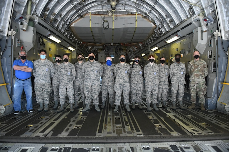 Air Force Junior Reserve Officers' Training Corps (AFJROTC) cadets pose for a group photo on a C-17 Globemaster III, at Altus Air Force Base (AFB), Oklahoma, March 10, 2021. The C-17 is capable of rapid strategic delivery of troops and all types of cargo to main operating bases or directly to forward bases in the deployment area. (U.S. Air Force photo by Airman 1st Class Kayla Christenson)