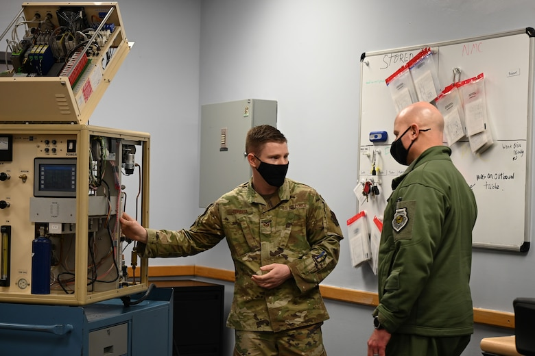 U.S. Air Force Staff Sgt. Thomas Cordua, a 709th Technical Maintenance Squadron (TMXS), Detachment 460 field maintenance supervisor, explains how an advanced automatic cryogenic rectifier (AACR) works to Col. David Berkland, the 354th Fighter Wing commander, during a leadership immersion on Eielson Air Force Base, Alaska, March 11, 2021.