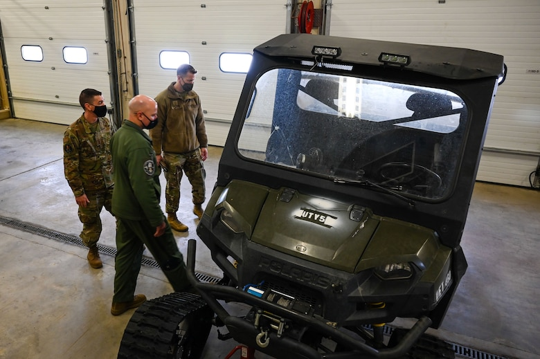 U.S. Air Force Senior Master Sgt. Aaron Boyle, left, the 709th Technical Maintenance Squadron (TMXS), Detachment 460 chief, shows a Utility Transport Vehicle to Col. David Berkland, the 354th Fighter Wing (FW) commander, and Chief Master Sgt. John Lokken, the 354th FW command chief, during a leadership immersion on Eielson Air Force Base, Alaska, March 11, 2021.